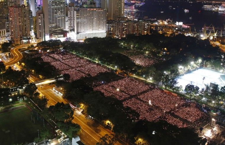 Tens of thousands of people attend a candlelight vigil at Victoria Park in Hong Kong, Thursday, June 4, 2015. Hong Kongers held a candlelight vigil Thursday night to mark the suppression of the 1989 student-led Tiananmen Square protests, an annual event that takes on greater meaning for the city's young after last autumn's pro-democracy demonstrations sharpened their sense of unease with Beijing. (AP Photo/Kin Cheung)