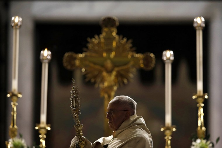 Pope Francis holds a monstrance containing a Holy Host at the end of the Corpus Domini procession from St. John at the Lateran Basilica to St. Mary Major Basilica to mark the feast of the Body and Blood of Christ, in Rome, Thursday, Italy, Thursday, June 4, 2015. The event is dedicated to the mystery of the Eucharist and concludes the cycle of feasts following Easter. (AP Photo/Gregorio Borgia)