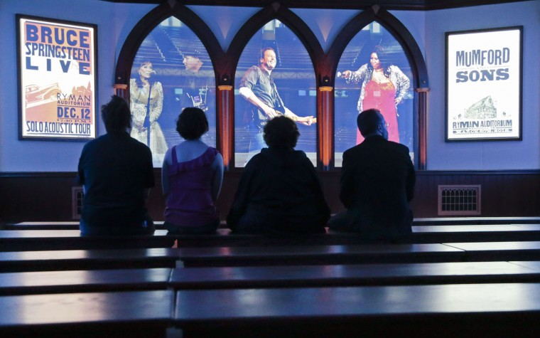 People view a multimedia show in a new theater at the Ryman Auditorium, Monday, June 8, 2015, in Nashville, Tenn. The Tennessean reports that the Ryman is ready for its grand reopening after a yearlong, $14 million expansion. (AP Photo/Mark Humphrey)