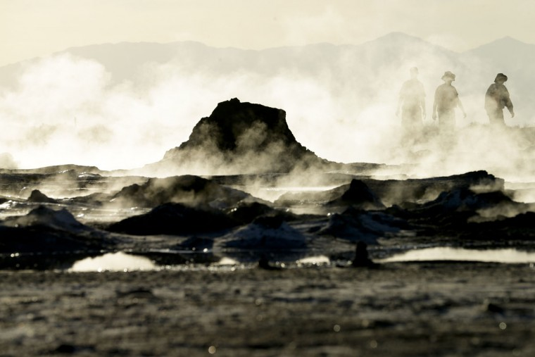 "In this April 29, 2015, photo, steam rises from geothermal mud pots near the banks of the Salton Sea near Niland, Calif., evidence of the region's vast geothermal activity. Often called the ""The Accidental Sea,"" because it was created when the Colorado River breached a dike in 1905, Salton Sea now faces a looming calamity as coastal Southern California clamors for more water. (AP Photo/Gregory Bull)"