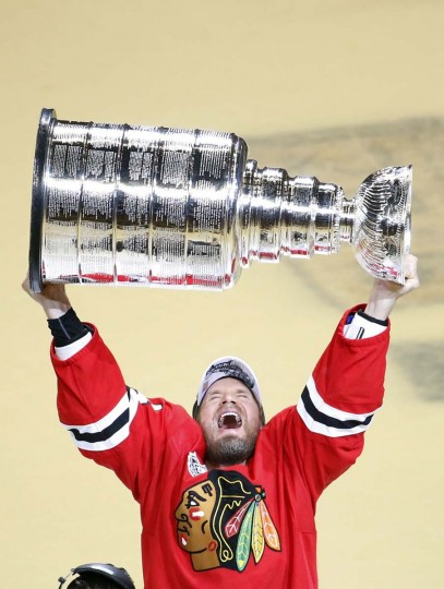 Chicago Blackhawksí Kimmo Timonen, of Finland, hoists the Stanley Cup trophy after defeating the Tampa Bay Lightning in Game 6 of the NHL hockey Stanley Cup Final series on Wednesday, June 10, 2015, in Chicago. The Blackhawks defeated the Lightning 2-0 to win the series 4-2. (AP Photo/Charles Rex Arbogast)