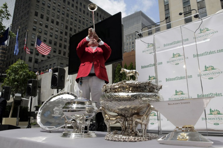 Belmont Park bugler Sam Grossman blows the call to the post before the post position draw for the 147th Belmont Stakes at New York's Rockefeller Center, Wednesday, June 3, 2015. American Pharoah was made the early 3-5 favorite on Wednesday to win the Belmont Stakes and become U.S. horse racing's first Triple Crown winner in 37 years. (AP Photo/Richard Drew)