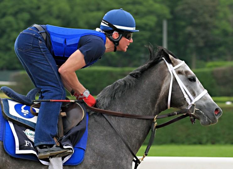 Exercise rider Lorenzo Moralez gallops Belmont Stakes entrant Frosted at Belmont Park race track in Elmont, NY, Thursday, June 4, 2015. (AP Photo/Garry Jones)