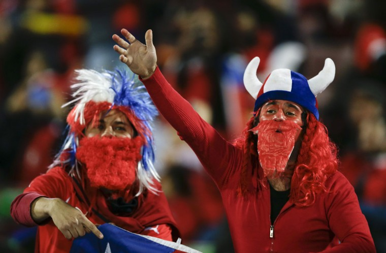 Chilean fans cheer during the opening ceremony of the Copa America soccer tournament at the National Stadium in Santiago, Chile, Thursday, June 11, 2015.(AP Photo/Ricardo Mazalan)