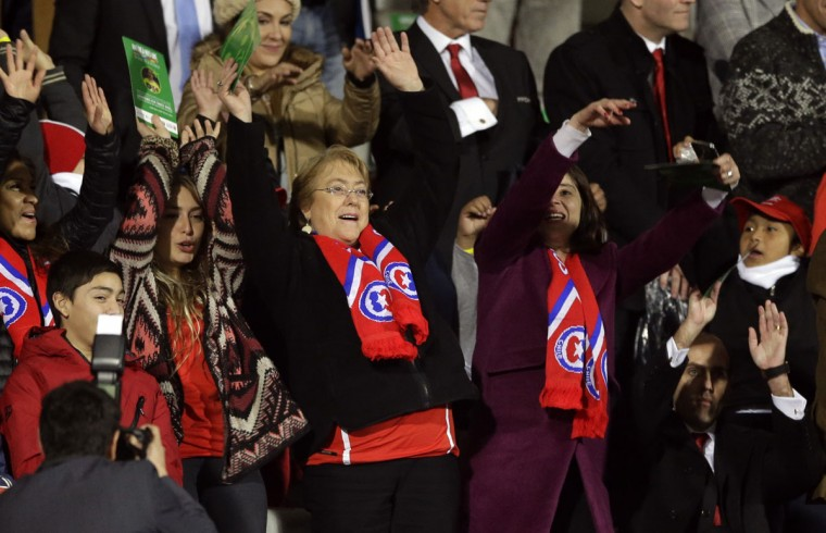 Chile's President Michelle Bachelet, center, cheers before the start of a Copa America Group 1 soccer match between Chile and Ecuador at the National Stadium in Santiago, Chile, Thursday, June 11, 2015.(AP Photo/Ricardo Mazalan)