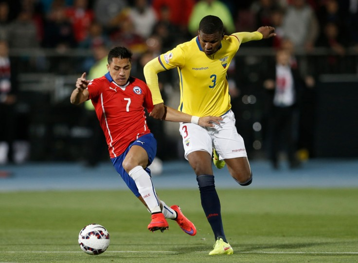 Chile's Alexis Sanchez, left, battle for the ball with Ecuador's Frickson Erazo during a Copa America Group 1 soccer match at the National Stadium in Santiago, Chile, Thursday, June 11, 2015.(AP Photo/Silvia Izquierdo)