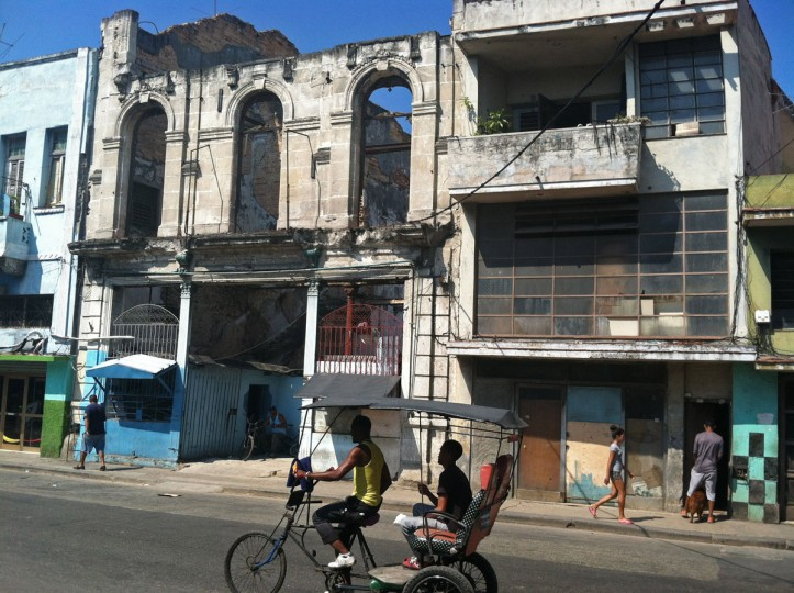 This May 17, 2015 photo shows a shell of a building with the sky visible behind it in downtown Havana, Cuba. The travel industry is promoting a romantic vision of Havana as frozen in time but the reality is not always so pretty. (AP Photo/Beth J. Harpaz)