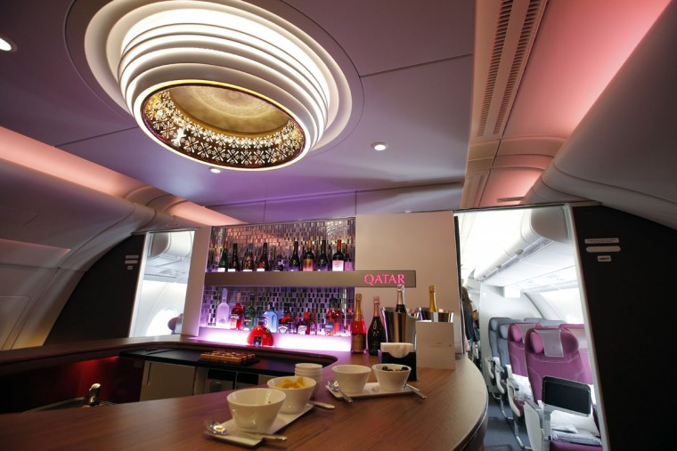Interior view of the lounge bar in the second floor deck of the Airbus A380 of Qatar Airways presented at the Paris Air Show, in Le Bourget airport, north of Paris, Wednesday, June 17, 2015. Qatar Airways has brought 4 Airbus A380's in service since last year. (AP Photo/Francois Mori)