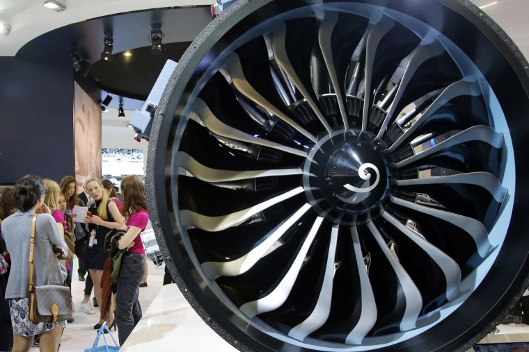 Visitors look at a Safran made engine at the Paris Air Show, in Le Bourget airport, north of Paris, Thursday, June 18, 2015. Some 300,000 aviation professionals and spectators are expected at this weekís Paris Air Show, coming from around the world to make business deals and see dramatic displays of aeronautic prowess and the latest air and space technology. (AP Photo/Francois Mori)