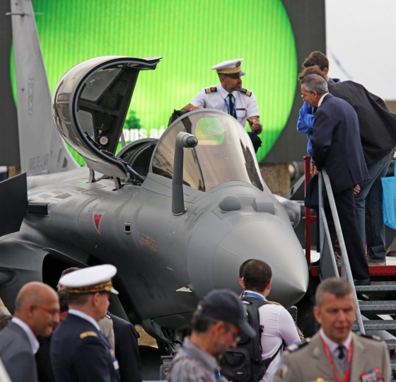 A French Air Force officer presents to visitors the cockpit of a Dassault made Rafale at the Paris Air Show in Le Bourget, north of Paris, Thursday June 18, 2015. Some 300,000 aviation professionals and spectators are expected at this weekís Paris Air Show, coming from around the world to make business deals and see dramatic displays of aeronautic prowess and the latest air and space technology. (AP Photo/Remy de la Mauviniere)