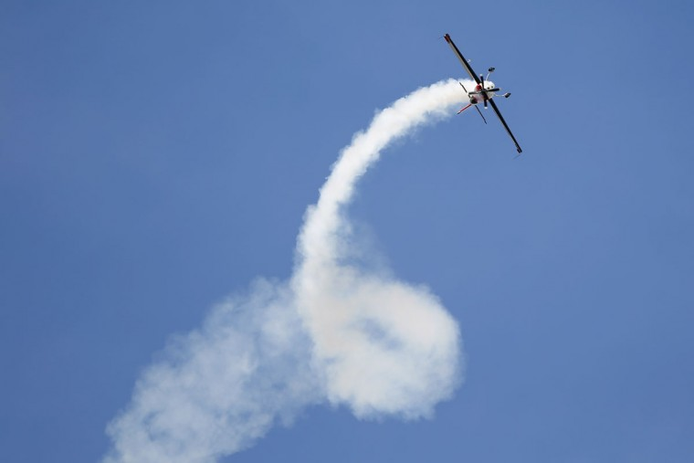Catherine Maunoury of France, 62, performs a demonstration flight with a low-wing aerobatic Extra C 330 aircraft at the Paris Air Show, in Le Bourget airport, north of Paris, Thursday, June 18, 2015. Some 300,000 aviation professionals and spectators are expected at this weekís Paris Air Show, coming from around the world to make business deals and see dramatic displays of aeronautic prowess and the latest air and space technology. (AP Photo/Francois Mori)