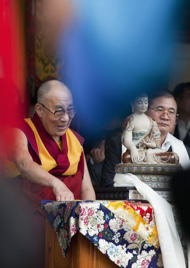 Tibetan spiritual leader the Dalai Lama, left, smiles during an official function to mark his 80th birthday in Dharmsala, India, Sunday, June 21, 2015. The Dalai Lama was born on July 6 according to the Gregorian calendar but his birthday this year falls on June 21 according to the lunar calendar followed traditionally by Tibetans. (AP Photo/Ashwini Bhatia)