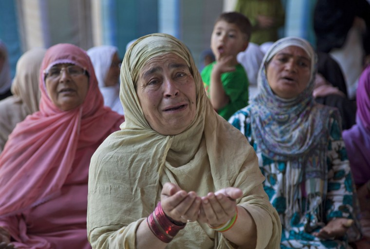 Kashmiri Muslim women pray outside Shah Hamadan Shrine on the first day of the holy month of Ramadan in Srinagar, Indian controlled Kashmir, Friday, June 19, 2015. Muslims throughout the world are marking the month of Ramadan, the holiest month in the Islamic calendar during which devotees fast from dawn till dusk. (AP Photo/Dar Yasin)