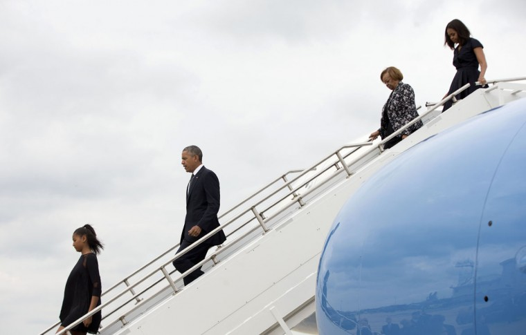 President Barack Obama, and family, from left, daughter Sasha, mother-in-law Marian Robinson, and first lady Michelle Obama get off Air Force One upon their arrival at Delaware Air National Guard base in New Castle, Del., Saturday, June 6, 2015. The First Family was traveling to Wilmington, Del. to attend the funeral service of former Delaware Attorney General Beau Biden, the vice president's eldest son. Biden died of brain cancer at the age 46. (AP Photo/Pablo Martinez Monsivais)