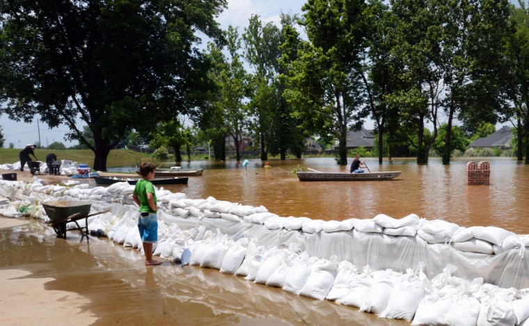 Payne Kuntz watches the high water in the Les Maisons Sur La Rouge subdivision. The Red River crested Monday, June 8, 2015, and likely will stay at or around its current level for the next few days before slowly decreasing, National Weather Service meteorologist Davyon Hill said. (Henrietta Wildsmith/The Shreveport Times via AP)