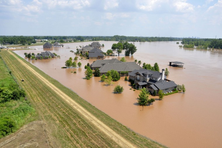 This photo released by the Bossier City Sheriff's Office shows a sandbagged home during flooding from the Red River in the River Bluff subdivision of Bossier City, La., Monday, June 8, 2015. The Red River leveled off at Shreveport on Tuesday. It reached 37.09 feet in the afternoon, meteorologist Davyon Hill said. (Bill Davis/Bossier City Sheriff's Office via AP)