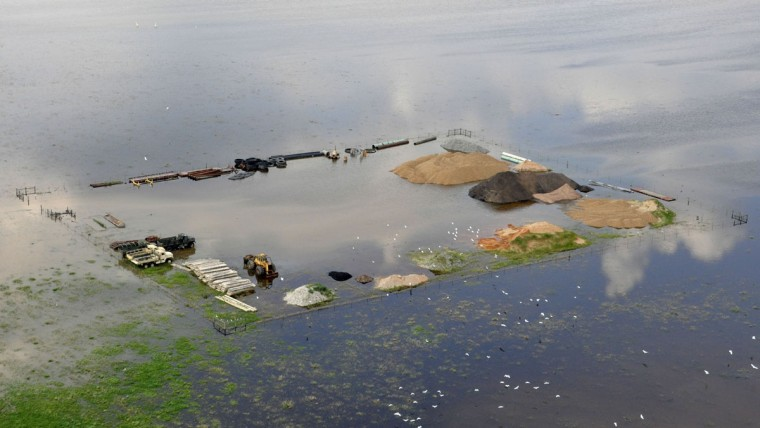 This photo released by the Bossier City Sheriff's Office shows flooding from the Red River at a construction site in South Bossier Parish, La., Monday, June 8, 2015. The Red River leveled off at Shreveport on Tuesday. It reached 37.09 feet in the afternoon, meteorologist Davyon Hill said. (Bill Davis/Bossier City Sheriff's Office via AP)