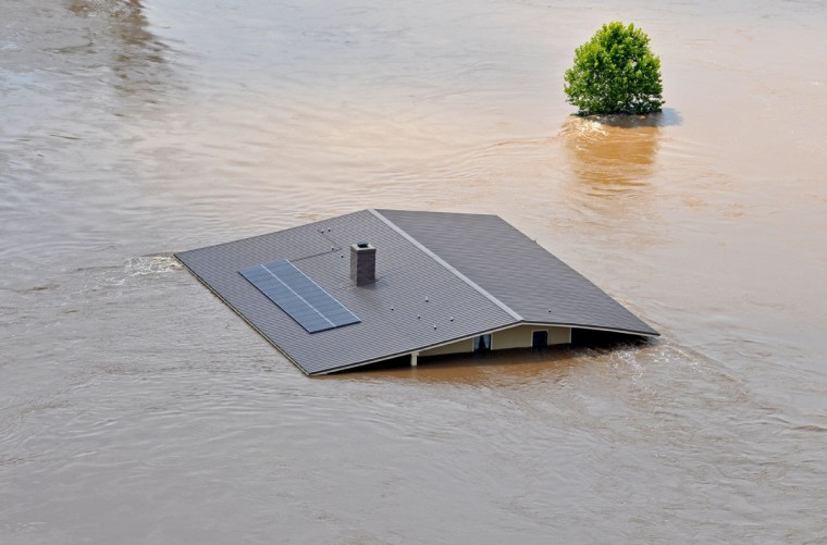 This photo released by the Bossier City Sheriff's Office shows a house under water during flooding from the Red River in Shreveport, La., Monday, June 8, 2015. The Red River leveled off at Shreveport on Tuesday. It reached 37.09 feet in the afternoon, meteorologist Davyon Hill said. (Bill Davis/Bossier City Sheriff's Office via AP)