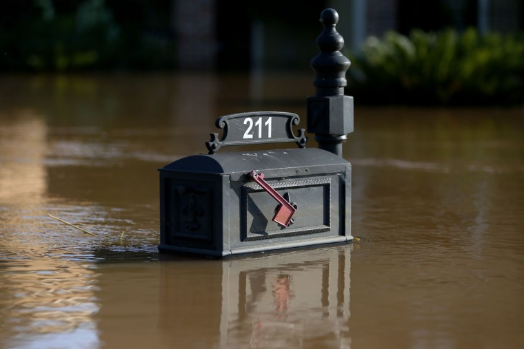 A partially submerged mailbox caused by flooding from the Red River is visible Wednesday, June 10, 2015, in Bossier City, La. (AP Photo/Jonathan Bachman)
