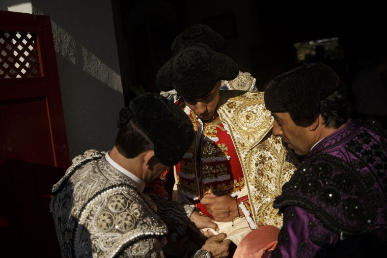 In this photo taken Saturday, May 30, 2015, Spanish bullfighter Alvaro Lorenzo gets his 'capote' adjusted in the bullring before a bullfight with Alcurrucen ranch fighting bulls in Aranjuez, near Madrid, Spain. Bullfighting is an ancient tradition in Spain. (AP Photo/Daniel Ochoa de Olza)