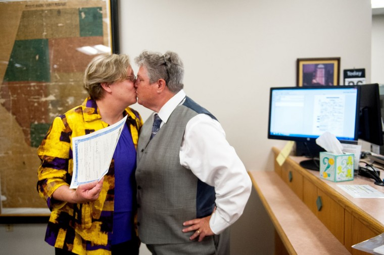From left, Laura Zinszer and Angela Boyle kiss after receiving their marriage license after the Supreme Courts ruling that same-sex couples have the right to marry in all 50 states on Friday, June 26, 2015 at the Recorder of Deeds office at the Boone County Government Center in Columbia, Mo. Zinszer and Boyle are Boone County's first same-sex couple to receive their marriage license. Missouri was one of the states affected by Friday's ruling. (Nick Schnelle/The Columbia Daily Tribune via AP)
