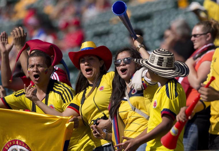 Colombia fans cheer for their team ahead of FIFA Women's World Cup round of 16 action against the United States in Edmonton, Alberta, Canada, Monday, June 22, 2015. (Jason Franson/The Canadian Press via AP)