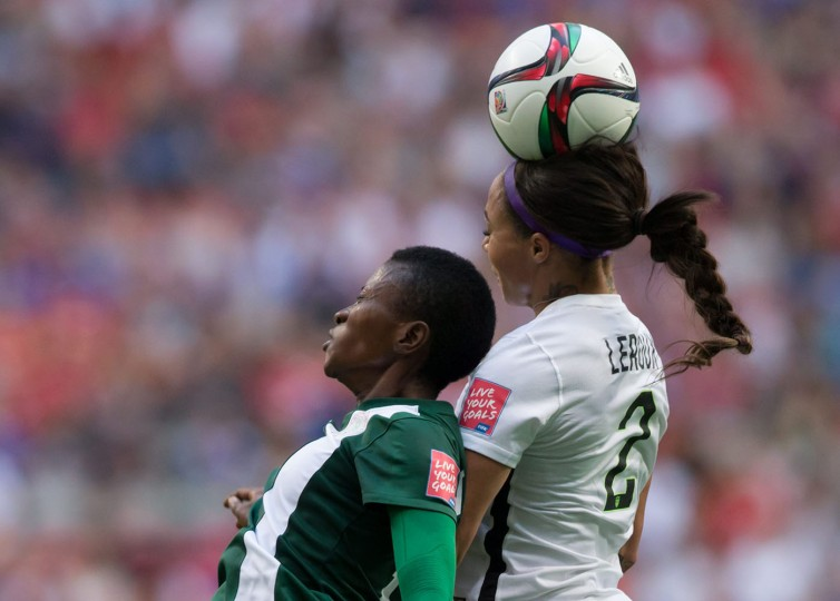 United States' Sydney Leroux, right, out jumps Nigeria's Evelyn Nwabuoku to get her head on the ball during the second half of a FIFA Women's World Cup soccer game Tuesday, June 16, 2105, in Vancouver, British Columbia, Canada. (Darryl Dyck/The Canadian Press via AP)