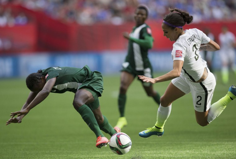 Nigeria's Josephine Chukwunonye, left, and United States' Sydney Leroux collide during the second half of a FIFA Women's World Cup soccer game Tuesday, June 16, 2105, in Vancouver, British Columbia, Canada. (Darryl Dyck/The Canadian Press via AP)