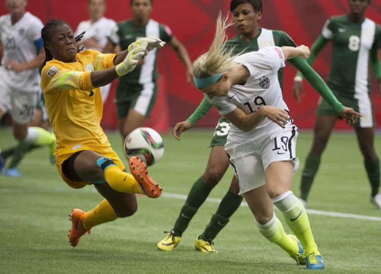 United States' Julie Johnston tries to get a shot past Nigeria goalkeeper Precious Dede during the first half of a FIFA Women's World Cup soccer game Tuesday, June 16, 2105, in Vancouver, British Columbia, Canada. (Darryl Dyck/The Canadian Press via AP)