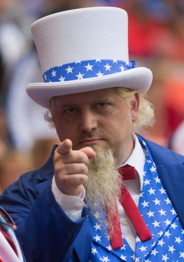 A U.S. fan gestures while waiting for a FIFA Women's World Cup soccer game between Nigeria and the United States, Tuesday, June 16, 2105, in Vancouver, British Columbia, Canada. (Darryl Dyck/The Canadian Press via AP)