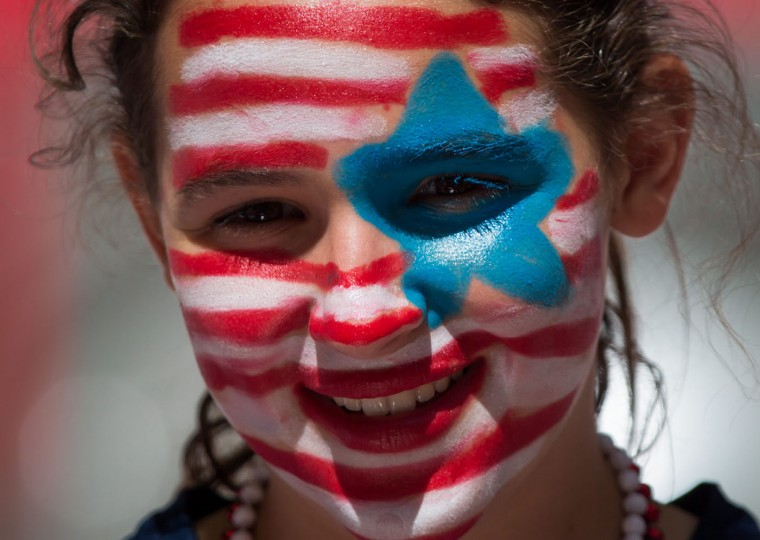 A young U.S. fan watches as the team warms up for a FIFA Women's World Cup soccer game between Nigeria and the United States, Tuesday, June 16, 2105, in Vancouver, British Columbia, Canada. (Darryl Dyck/The Canadian Press via AP)