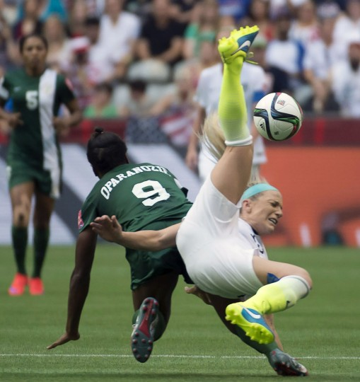 United States' Julie Johnston fights for control of the ball with Nigeria's Desire Oparanozie during the second half of a FIFA Women's World Cup soccer match, Tuesday, June 16, 2015 in Vancouver, New Brunswick, Canada. (Jonathan Hayward/The Canadian Press via AP)