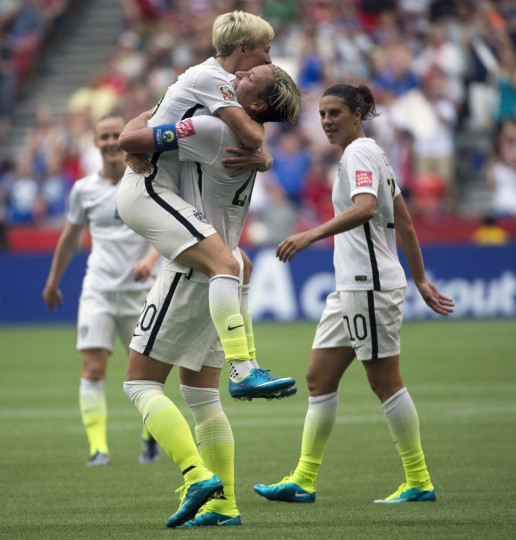 United States' Abby Wambach celebrates her goal with teammate Megan Rapinoe during the first half of a FIFA Women's World Cup soccer match against Nigeria, Tuesday, June 16, 2015 in Vancouver, New Brunswick, Canada. (Jonathan Hayward/The Canadian Press via AP)