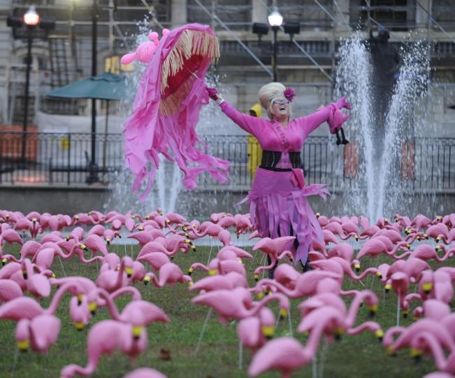 "Charlene Osborne, ""Bawlmer""'s Best Hon of 2009 celebrates with a flock of plastic flamingoes in War Memorial Plaza. (Jed Kirschbaum/Baltimore Sun)"