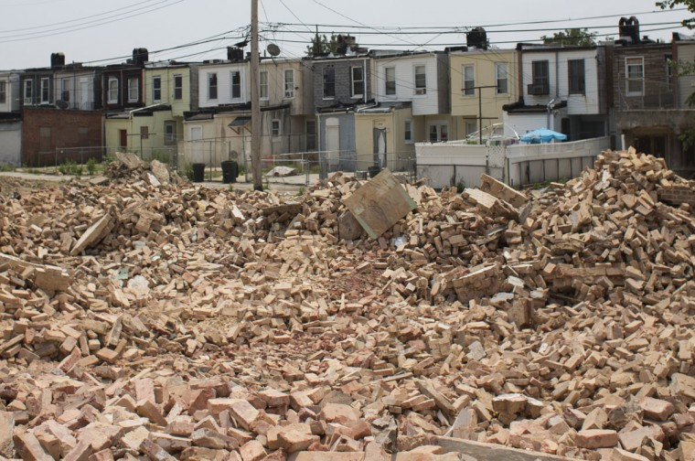Hundreds of bricks remain from a previous demolition job on a home on Tivoly Avenue through the mayor's Vacants to Value program. To date, Vacants to Value has leveraged more than $107 million dollars in private investment to demolish or rehabilitate more than 3,000 vacant homes. Tom Brenner / The Baltimore Sun.