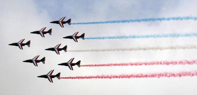 The Patrouille de France performs for the inauguration of the 51st International Paris Air Show at Le Bourget airport, in the north of Paris, France, 15 June 2015. The Paris Air Show runs from 15 June to 21 June 2015. (AP Photo/Remy de la Mauviniere)