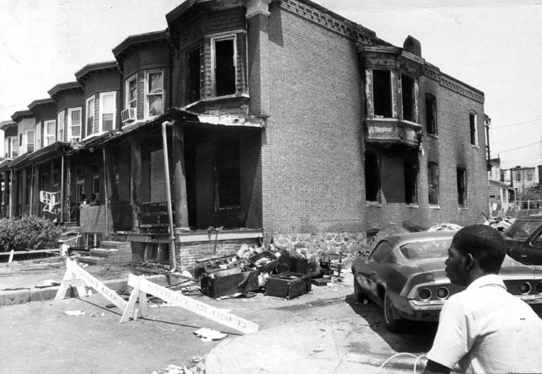 1982-- A youngster surveys the charred shell of the Tivoly Avenue home. Photo by William H. Mortimer/file photo