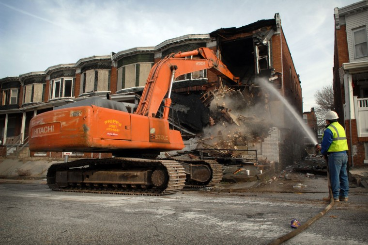Jan. 2008: Demolition crews begin tearing down 2731 Tivoly. As part of the city's blight elimination effort, demolition crews began tearing down vacant homes in the 2700 block of Tivoly in East Baltimore. Andre F. Chung / Baltimore Sun