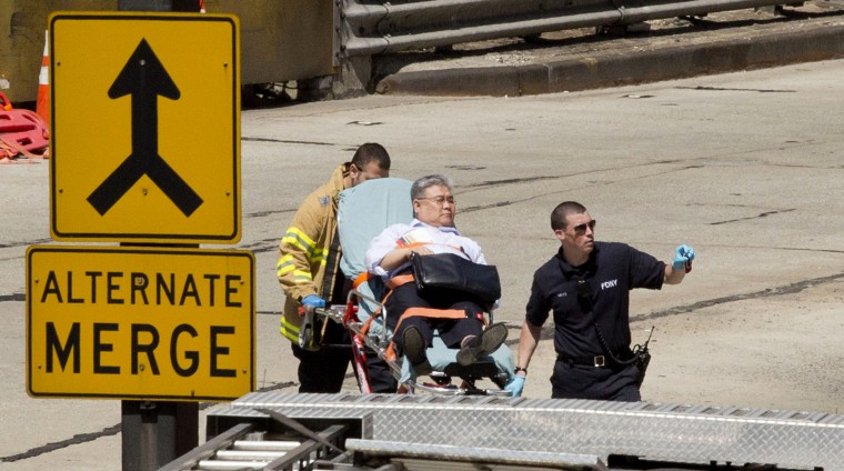 An injured person is carried on a stretcher to an ambulance at the entrance to the Lincoln Tunnel in New York. A New Jersey transit bus rear-ended a private bus carrying Canadian schoolchildren inside the Lincoln Tunnel, injuring 31 people and slowing traffic on one of the busiest routes for commuters entering and leaving New York City, authorities said. None of the 26 students and two adults from the Toronto school was hurt, according to Anna Caputo, spokeswoman for the Toronto District School Board. (Mark Lennihan/Associated Press)