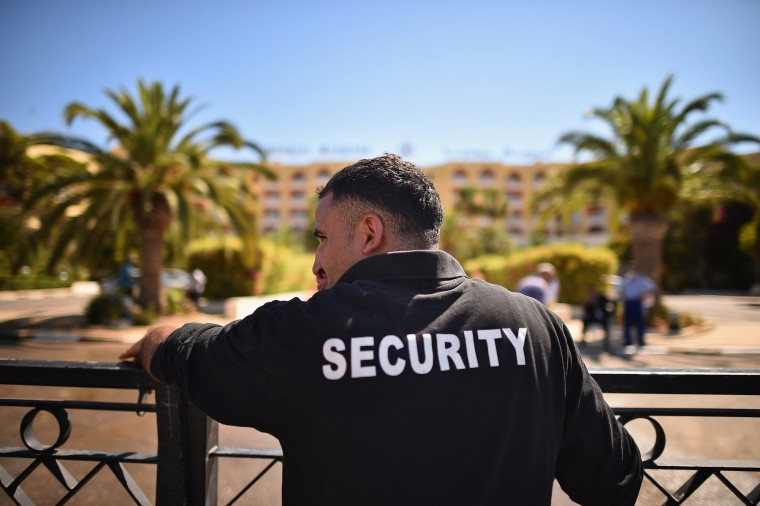 Men stand at the front of the Imperial Marhaba Hotel where 38 people were killed yesterday in a terrorist attack on in Souuse,Tunisia. Habib Essid Prime Minister of Tunisia announced a clampdown on security after the attack on a holiday resort. (Jeff J Mitchell/Getty Images)