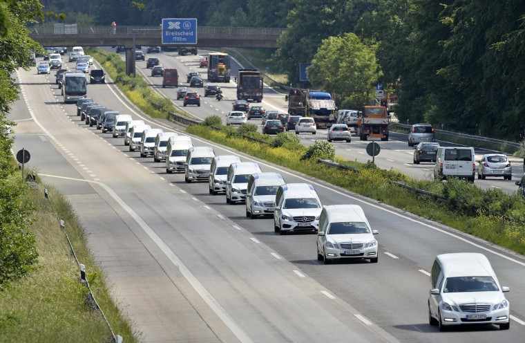 A convoy of hearses drives on the highway in Duisburg, Germany, taking home 16 school children who died in the Germanwings plane crash in March. The coffins, that arrived at the airport in Duesseldorf Tuesday evening, are brought to their families in the city of Haltern. (Martin Meissner/Associated Press)