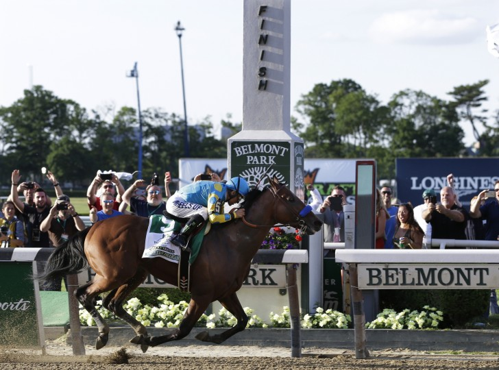 American Pharoah (5) with Victor Espinoza up crosses the finish line to win the 147th running of the Belmont Stakes horse race at Belmont Park, Saturday, June 6, 2015, in Elmont, N.Y. American Pharoah is the first horse to win the Triple Crown since Affirmed won it in 1978. (Seth Wenig/Associated Press