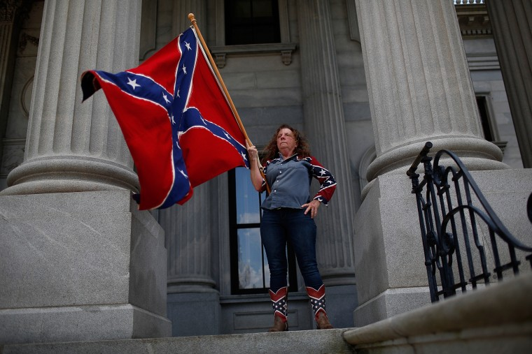 Alice Dixie Horky, of Greenville, South Carolina joins a group of demonstrators on the steps of the South Carolina State House calling for the Confederate flag to remain on the State House grounds in Columbia, South Carolina. Earlier in the week South Carolina Gov. Nikki Haley expressed support for removing the Confederate flag from the State House grounds in the wake of the nine murders at Mother Emanuel A.M.E. Church in Charleston, South Carolina. (Win McNamee/Getty Images)
