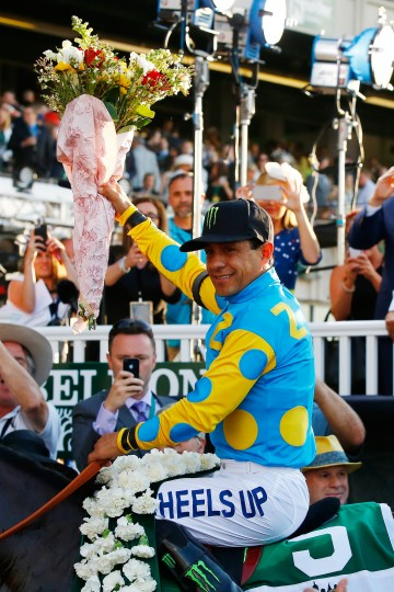 Victor Espinoza, celebrates atop American Pharoah #5, in the winner's circle after winning the 147th running of the Belmont Stakes at Belmont Park on June 6, 2015 in Elmont, New York. With the wins American Pharoah becomes the first horse to win the Triple Crown in 37 years. (Al Bello/Getty Images)