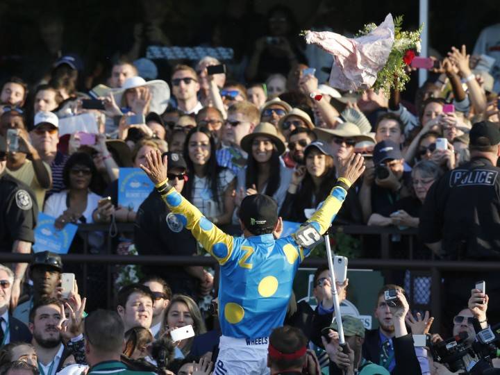 Victor Espinoza reacts to the crowd after guiding American Pharoah to win the 147th running of the Belmont Stakes horse race at Belmont Park, Saturday, June 6, 2015, in Elmont, N.Y. American Pharoah is the first horse to win the Triple Crown since Affirmed won it in 1978. (Julio Cortez/Associated Press)