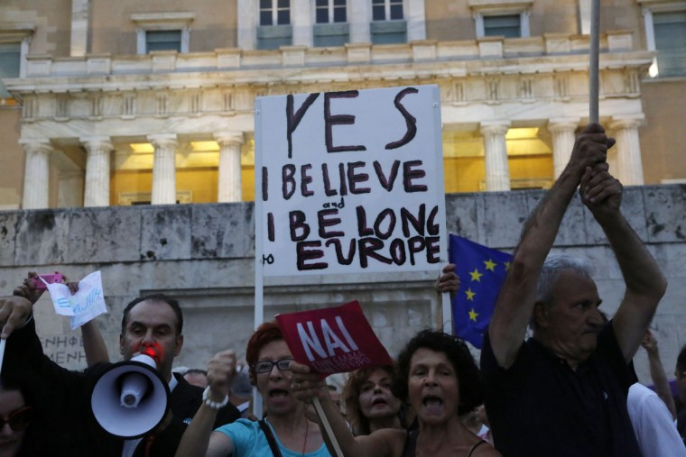 Demonstrators shout slogans during a rally organized by supporters of the YES vote for the upcoming referendum in front of the Greek Parliament in Athens, Tuesday, June 30, 2015. (AP Photo/Petros Karadjias)