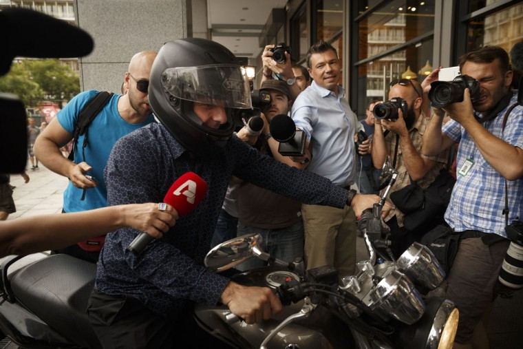 Greece's Finance Minister Yanis Varoufakis is surrounded by media as he leaves from his office in Athens, Tuesday, June 30, 2015. (AP Photo/Daniel Ochoa de Olza)