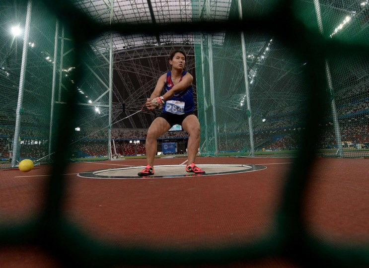 Mingkamon Koomphon of Thailand competes in the final of the women's hammer-throw athletics event during the 28th Southeast Asian Games (SEA Games) in Singapore on June 9, 2015. (MANAN VATSYAYANA/AFP/Getty Images)