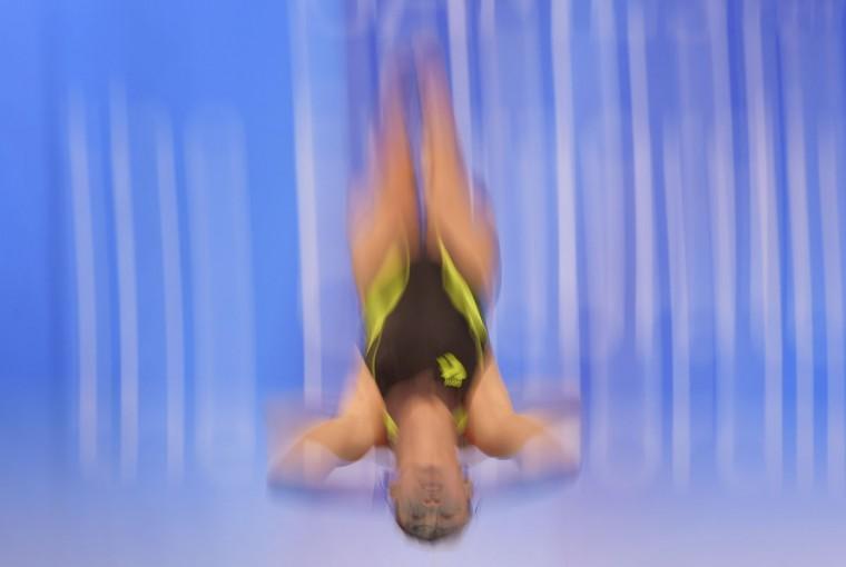 Pandalela Rinong Pamg of Malaysia dives in the women's 10-meter platform final at the SEA Games in Singapore Tuesday, June 9, 2015. (AP Photo/Joseph Nair)