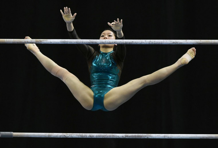 Vietnam's PhanThi Ha Thanh competes on the uneven bars during the women's individual all-around gymnastics final at the 28th Southeast Asian Games (SEA Games) in Singapore on June 8, 2015. (ROSLAN RAHMAN/AFP/Getty Images)